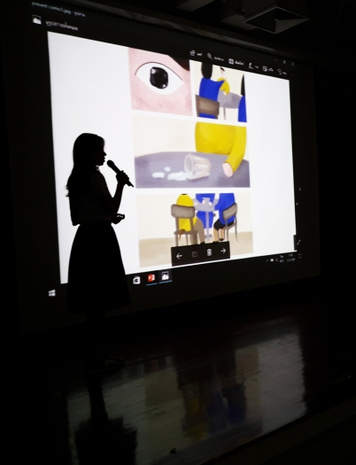 """CommDe student presenting her Traumics (or """"Comics on Trauma"""") to Ephameron and CommArts students."""