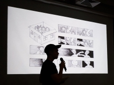"""CommDe student presenting his Traumics (or """"Comics on Trauma"""") to Ephameron and CommArts students."""