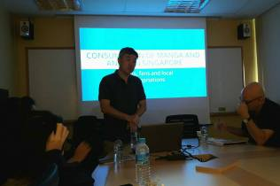 "Singaporean comics scholar Lim Cheng Tju holding his presentation on ""Consumption of Manga and Anime in Singapore""."